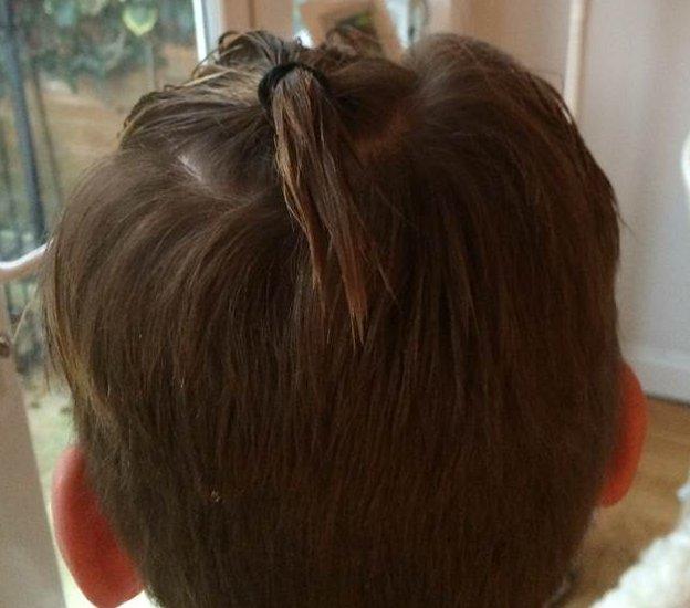 _81284445_joe_head_ponytail