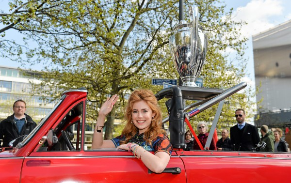 Palina Rojinski with the UEFA Champions League trophy on a Trabi at Breitscheidplatz during the UEFA Champions League City Tour - Legendary Moments, Berlin